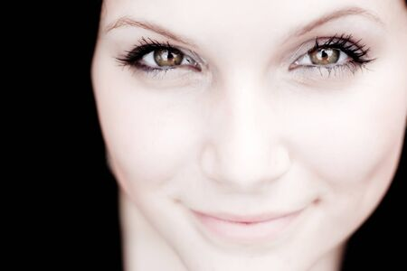 Close up of a beautiful young womans pretty face with copy space in sepia tone.  Shallow depth of field with sharpest focus on the eyes. photo