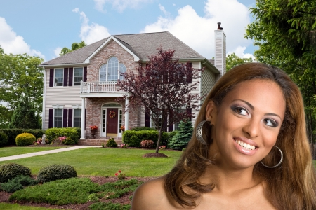 A young woman dreams of owning her own home. Stock Photo