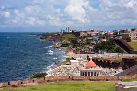 rico: The outer walls of El Morro fort and Santa Maria Magdalena de Pazzis colonial era cemetery located in Old San Juan Puerto Rico. Stock Photo