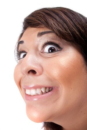 scheming: Woman with a funny look on her face smiles over a white background.