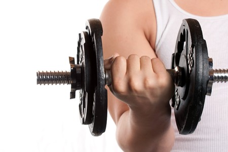 A young man lifting a dumbbell isolated over a white background. Stock Photo - 7795223