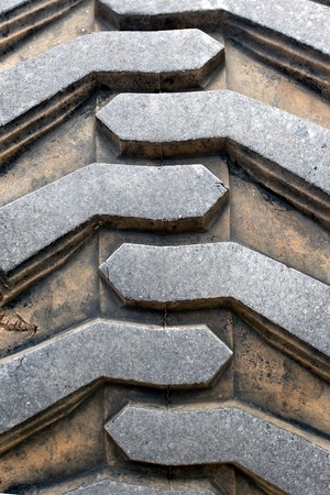 Detail up close of a tire tread from a tractor or other heavy duty construction machinery.  photo