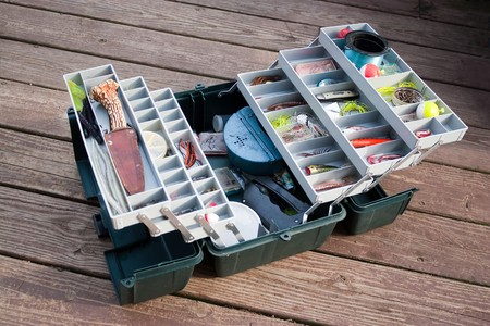 tackle: A large fishermans tackle box fully stocked with lures and gear for fishing.
