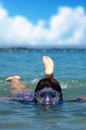A Hispanic woman snorkeling in the tropical waters of the Caribbean sea. photo