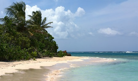 rican: Panorama of the gorgeous white sand filled Flamenco beach on the Puerto Rican island of Culebra. Stock Photo