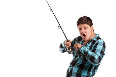 A teenager is surprised as he reels in a big fish.  Isolated over white in studio with plenty of negative space. photo
