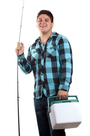 A young man poses with his fishing reel and beer cooler isolated over white in studio with negative space. photo