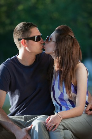 A young happy couple making out kissing. photo