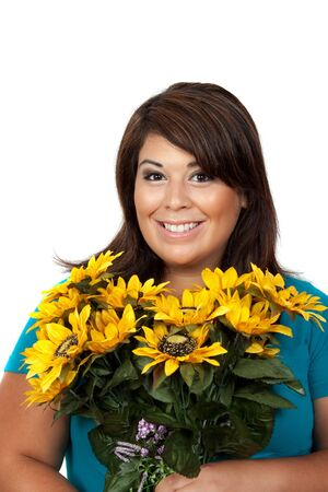 This young smiling hispanic woman looks totally and completely pleased with this bouquet of sunflowers. Stock Photo - 7927650