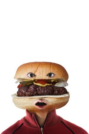 Een man met een hamburger als een hoofd.  Zij zeggen dat je bent wat je eet!   Stockfoto