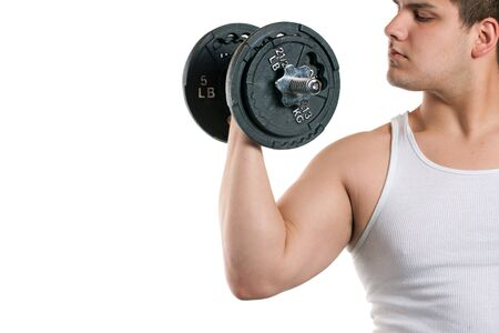 A young man curling a dumbbell over a white background. photo