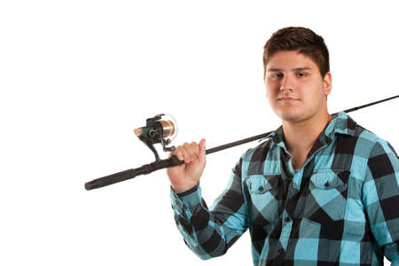 A young man poses with his fishing reel isolated over white in studio with negative space. photo