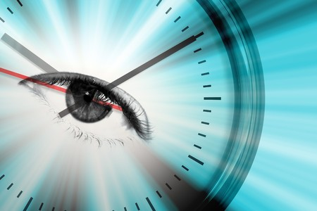 Conceptual montage themed around time or upcoming events with a clock and an eye in the center of the dial. photo