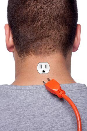toma corriente: Imagen conceptual de un hombre joven con una toma el�ctrica en la parte posterior de su cuello con el enchufe de alimentaci�n desconectado.