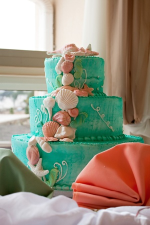A blue beach themed wedding cake with three tiers. Stock Photo - 8347825