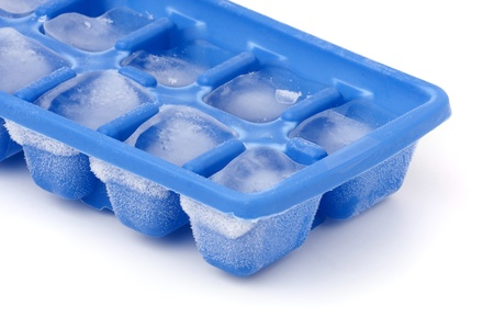 trays: A blue plastic ice cube tray with frost on it isolated over a white background.