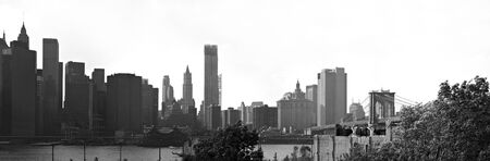 A panoramic image of the New York City Manhattan skyline including the Brooklyn bridge  bridge.