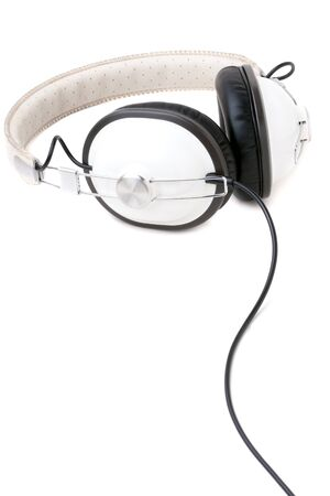 A set of retro style head phones isolated over a white background. photo