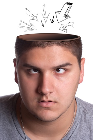 cut off head: A young man looking up toward his opened head with arrows pointing in towards his brain. Stock Photo