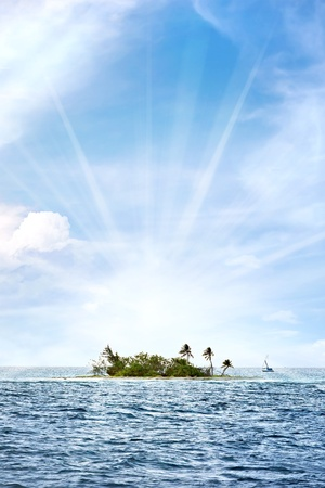 rico: A small desert island off the coast of Puerto Rico called Palominito with bright lens flare. Stock Photo