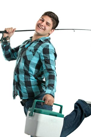 A young man poses with his fishing reel and beer cooler isolated over a white background.