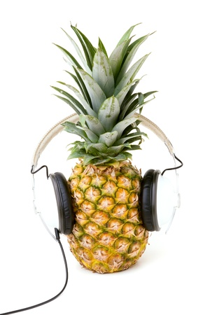 listen to music: A fresh ripe pineapple wearing headphones isolated over a white background.