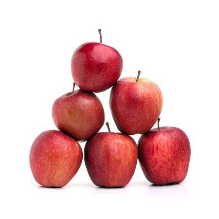 pyramid shape: A pyramid of red delicious apples on a white background.