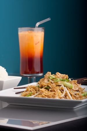 A Thai dish of crisy noodles and bean sprouts in a large white bowl with chop sticks. Stock Photo - 9019178