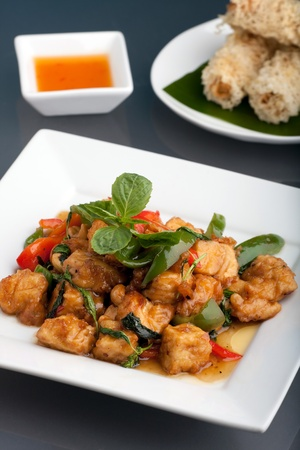 Fresh Thai food stir fry with fried tofu and egg roll appetizers. photo