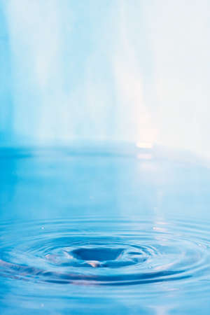 water wave: Close up of some clear blue water with circular ripples and plenty of copyspace.