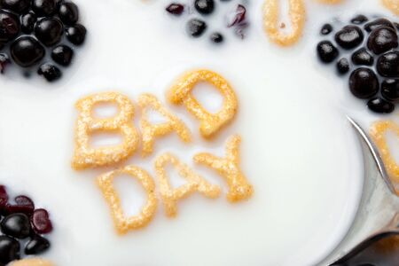 premenstrual syndrome: A bowl of alphabet cereal pieces floating in milk with the words BAD DAY spelled out. Stock Photo