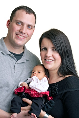 child couple: A young happy and healthy family isolated over white holding their newborn baby girl.
