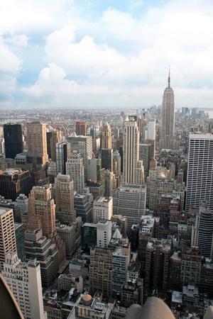 Vertical aerial view of the Manhattan section of New York City including all of the buildings and skyline.