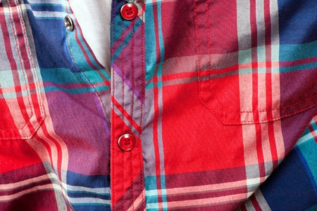 Close up detail of a red plaid button up style shirt. photo