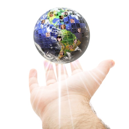 An abstract conceptual montage of a hand holding up the earth filled with people of all different races nationalities and background.  Great for social media and communications concepts. photo