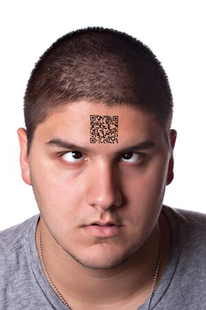 up code: A young man that looks very tired and cross eyed with his eyes looking upward towards his forehead. Stock Photo