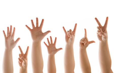A variety of hands and finger gestures isolated over a white background. photo