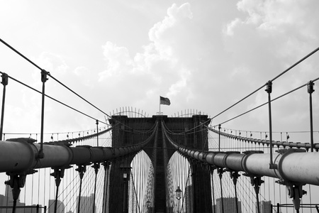 The world famous and historic Brooklyn Bridge located in New York City. Black and white.