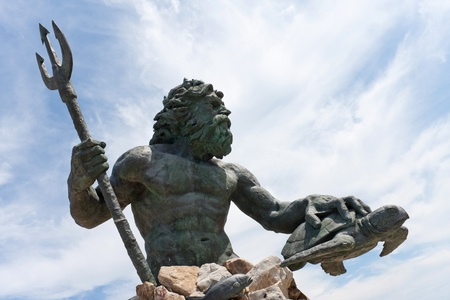 king neptune: Close up detial of a large public statue of King Neptune  that welcomes all to Virginia Beach in Virginia USA. Stock Photo