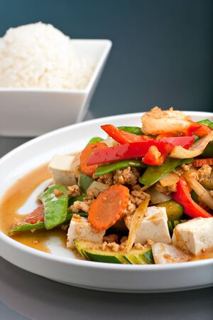 Fresh Thai food stir fry with tofu and white jasmine rice.  photo