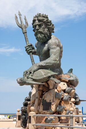 A large public statue of King Neptune  that welcomes all to VA beach in Virginia USA.