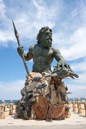 bronze: A large public statue of King Neptune  welcomes all to Virginia Beach in Virginia USA. Stock Photo