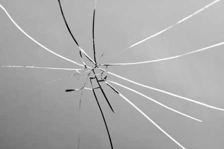 crack: Busted glass that is cracked and shattered. Stock Photo