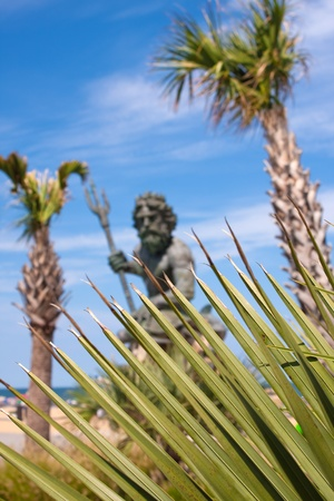 king neptune: The large public statue of King Neptune in Virginia Beach.  Shallow depth of field with sharp focus on the green tropical foliage.