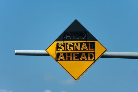 Light up roadway sign that tells when there is a red traffic signal ahead. photo