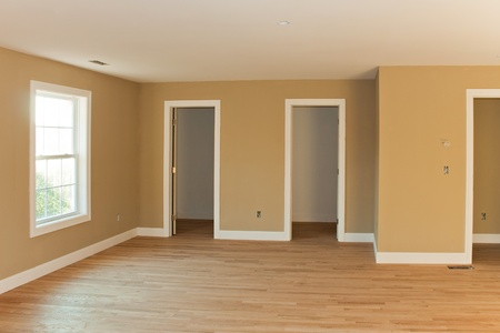 New home construction interior room with unfinished wood floors and twin closets.  The electrical and hvac connections also are partially unfinished. Stock Photo - 11921423