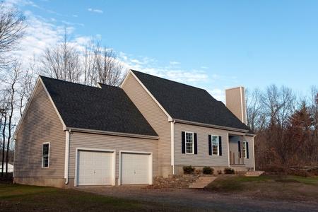 suburbs: Modern custom built house newly constructed with a 2 car garage in a residential neighborhood.   Stock Photo