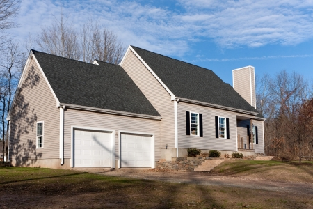 house siding: Modern custom built residential home newly constructed with a 2 car garage in a residential neighborhood.