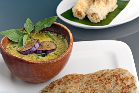 A dish of fresh Thai green curry soup with pancakes and appetizers. Stock Photo - 12746156