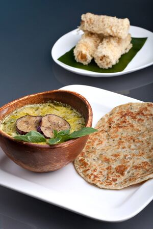 A dish of fresh Thai green curry soup with pancakes and appetizer. Stock Photo - 13104656